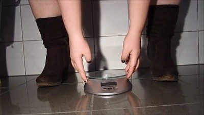 Shitting with boots on the scale
