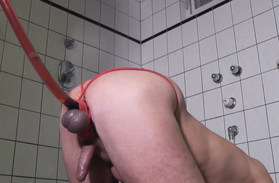 Slave ass gets red enema